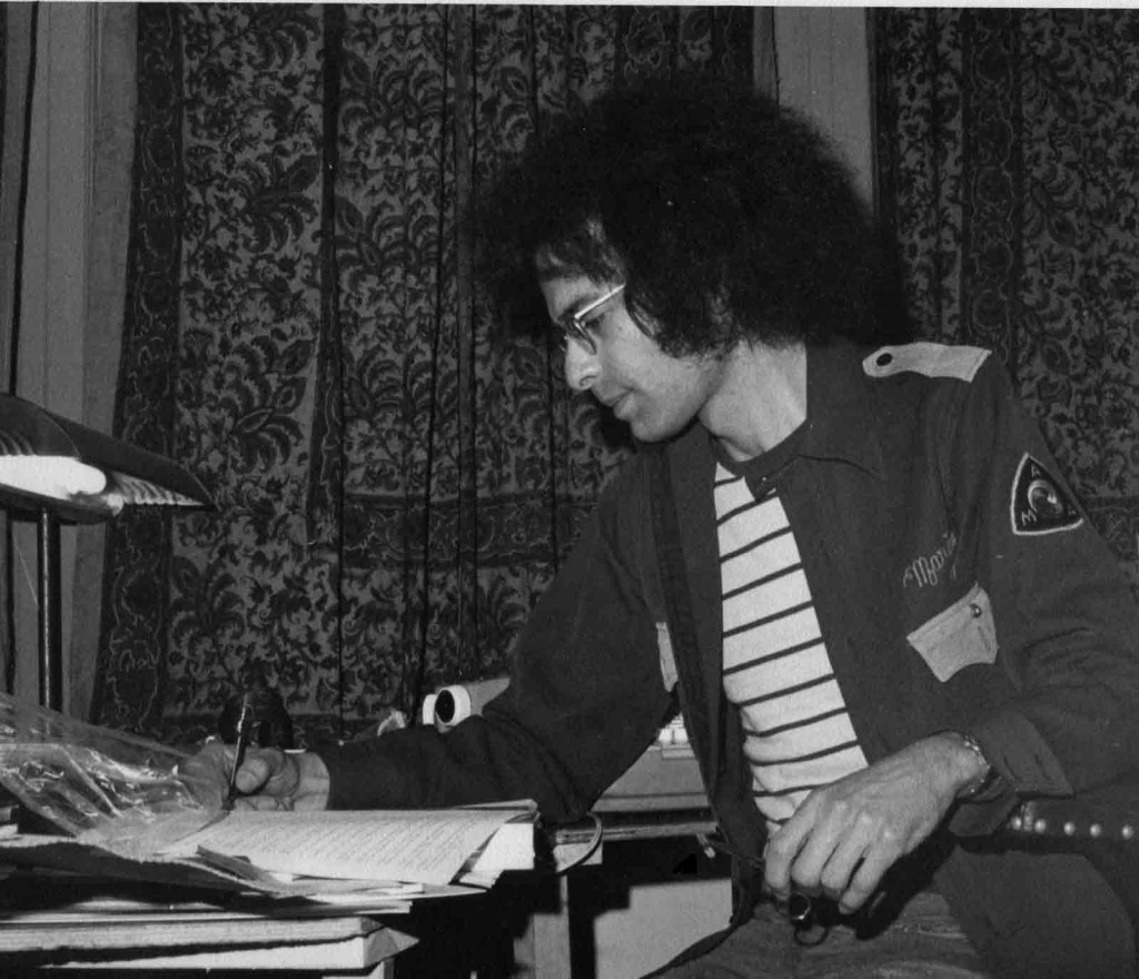 Michael Horowitz, with pen and roach clip, working with a Leary manuscript. San Francisco, Ludlow Library, 1972.